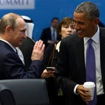 FILE - In this Monday, Nov. 16, 2015, file photo, U.S. President Barack Obama, right, talks with Russian President Vladimir Putin prior to a session of the G-20 Summit in Antalya, Turkey. For President Vladimir Putin, the terror attacks in Paris marked a watershed moment in relations with the West. This week's summit in Turkey made it clear that the U.S. and its allies have warmed to the idea of closer ties with Russia, whose help they need to confront the challenge of the Islamic State group.  (Kayhan Ozer/Anadolu Agency via AP, Pool, File)