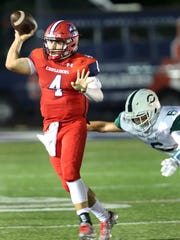 Stepinac's Quarterback Michael Nicosia (4) looks to pass the ball during the Joseph R. Riverso Memorial football game against Cornwall at the high school in White Plains on Sept. 9, 3016.