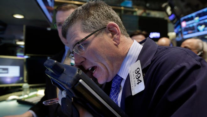 Trader Sean Spain works on the floor of the New York Stock Exchange.
