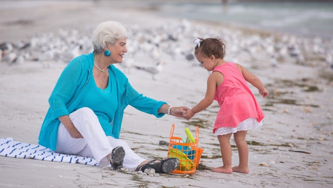 Nancy Schlossberg on the beach at Longboat Key, Fla. with her granddaughter Stevie, 2 1/2, and her daughter-in-law Michele Schlossberg.