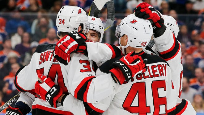 The New Jersey Devils celebrate a second period goal by New Jersey Devils defenseman Steven Santini against the Edmonton Oilers  at Rogers Place. The goal was the first of the Mahopac native's NHL career.