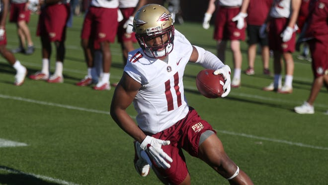 FSU's Nyqwan Murray runs with the ball during spring practice at the Al Dunlap Training Facility on Wednesday, March 21, 2018.