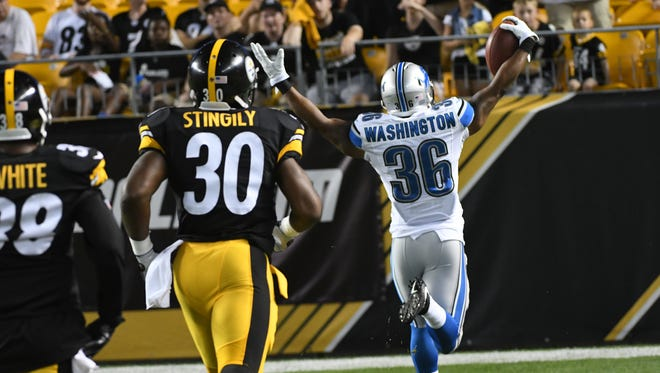 Lions rookie running back Dwayne Washington celebrates in the end zone his  96-yard kick return for a touchdown in the fourth quarter.