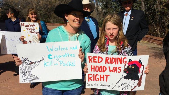 Ashley Ivins and her daughter, Ryleigh Lamb, from Lincoln County calmly displayed their signs in Santa Fe, offering a counter view of wolf releases.