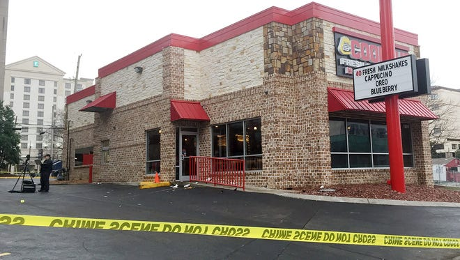 Police investigate a shooting in the parking lot of the Cook Out restaurant on West End Avenue.