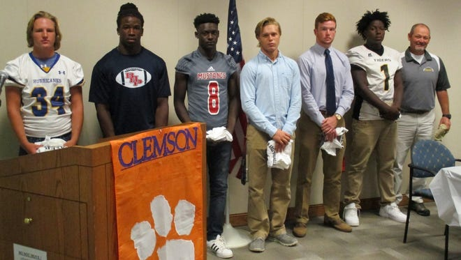 Shown from left are Johnathan Cobb, Eddie Smith, Dez Frazier, Gavin Agin, Alex Meredith, D.D. Hull and Coach Jeff Murdock. Not pictured: Malik Blassingame.