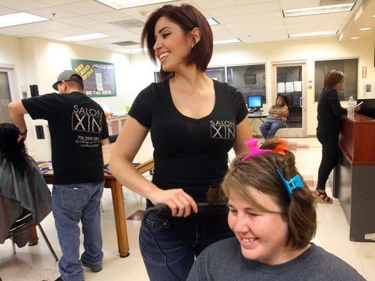 Stylist Michelle Estrada from Salon XIN works on Ashley Depue's hair during a special Mother's Day event at Martha's Village on Friday, May 6, 2016.