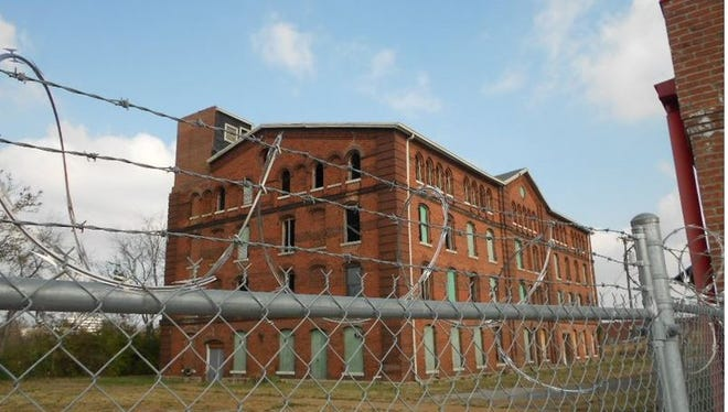 Cottage Partners LLC is working on plans to repurpose this 1865-built tobacco warehouse on 21st Avenue North.