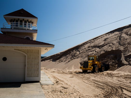 Frank Phaff of Silver Lake removes sand from the location