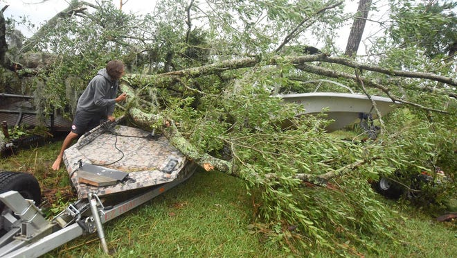 Downed trees and limbs were a common sight in Brunswick County after Hurricane Isaisas blew through the area three weeks ago. The county is bringing in private contractors to help with debris monitoring and pickup in unincorporated areas.