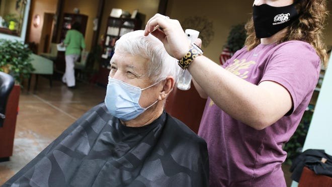 Hollis Thigpen gets a haircut at the Beauty Box Salon in Kinston Wednesday, Sept. 2, from hairdresser Courtney Williams.