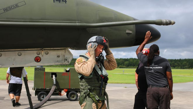 Draken International chief pilot Dan Holmes puts his helmet on before he takes off from the Global TransPark Thursday, Sept. 10, on a tactical interception mission.
