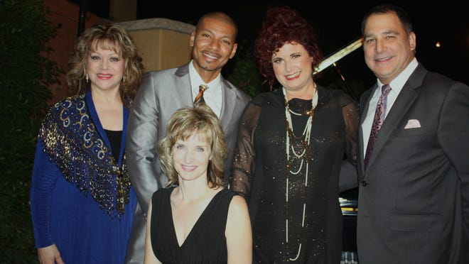 From left, Lola Rossi, Cedric Berry, Karen Benjkamin, Patrick Evans, Cathy Miller (seated) take a moment before the entertainment.
