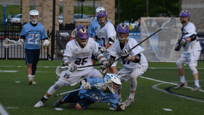 Michael Leva (21) is taken to the ground by the aggressive CBA defense during the first half of Westlake's 12-5 loss in the NYSPHSAA Class D final at St. John Fisher College on Saturday.
