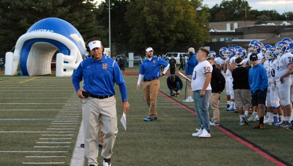 First-year Mahopac coach Dominick DeMatteo converses