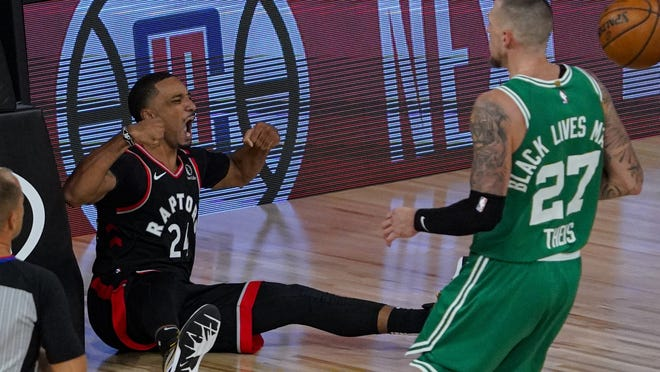 Toronto Raptors guard Norman Powell (24) celebrates after being fouled by Boston Celtics center Daniel Theis (27) during the second half of an NBA conference semifinal playoff basketball game Wednesday, Sept. 9, 2020, in Lake Buena Vista, Fla.