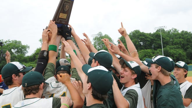Athens Bible players crowd around after they were presented the 2008 AHSAA Class 1A baseball championship trophy following their win over Providence Christian at Paterson Field on Wednesday, May 14, 2008.