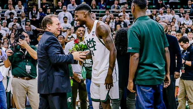 MSU Men's Basketball Head Coach Tom Izzo ,left, shakes hands with senior Eron Harris during Senior Day celebrations after the Spartans' game with Wisconsin Sunday February 26, 2017 in East Lansing.  KEVIN W. FOWLER PHOTO
