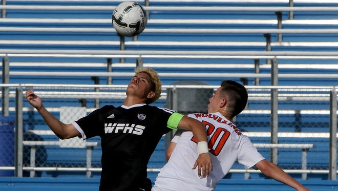 Wichita Falls High School's Alex Ramirez watches the ball as he battles with Frisco Wakeland's Simeon Salazar in the UIL Soccer State Championship semifinal Thursday, April 13, 2017, at Birkelbach Field in Georgetown.