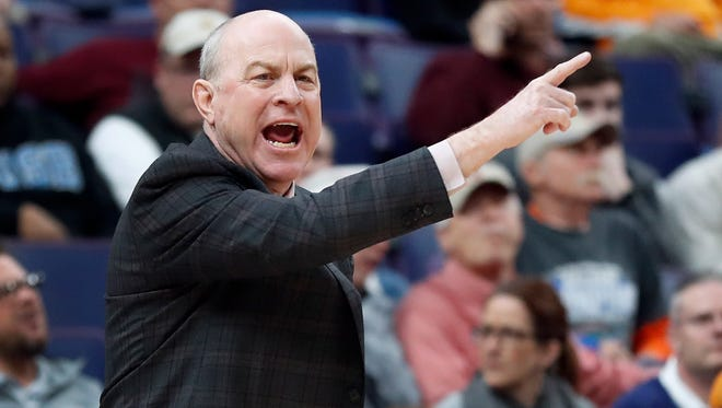Mississippi State head coach Ben Howland directs his team during the first half of an NCAA college basketball quarterfinal game against Tennessee at the Southeastern Conference tournament.