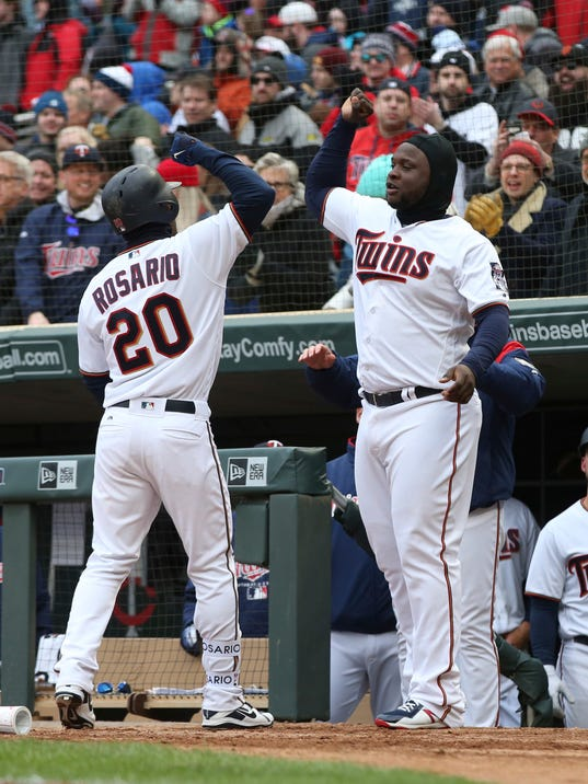 Minnesota Twins' Eddie Rosario, left, is congratulated by Miguel Sano after his solo home run off Seattle Mariners' pitcher Nick Vincent in the eighth inning of a baseball game Thursday, April 5, 2018, in Minneapolis. (AP Photo/Jim Mone)