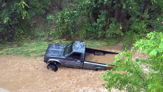 A truck was washed away on 19th Street in Silver City on Thursday. No injuries were reported as the driver and the passenger were able to get out.