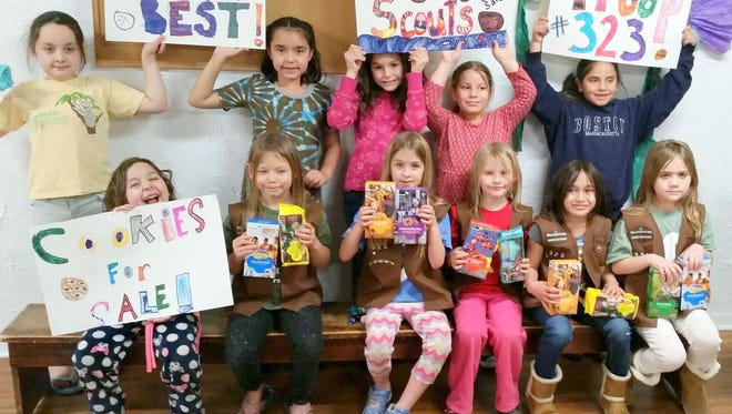Front row, from left, are Rylee Reyes, Hayley Mendoza, Samantha Armstrong, Denise Kirkpatrick, Annaleah Mendoza and Lilly James. Back row, from left, are Hailey Peterson, Ellena Bertolani, Sophie Landreth, Raelyn Bjorkman, and Angelina Hernandez. This Desert of the Southwest Girl Scout Troop 54323 is showing off the cookies for sale this year. They have also been practicing giving back change for the cookie sale.
