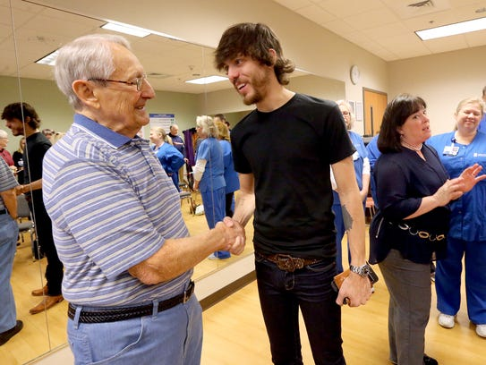 Ray Fairbanks, left, gets a chance to talk with country