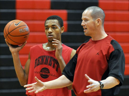 James M. Bennett basketball coach Dean Sullivan works on a drill with his players during a 2012 practice.