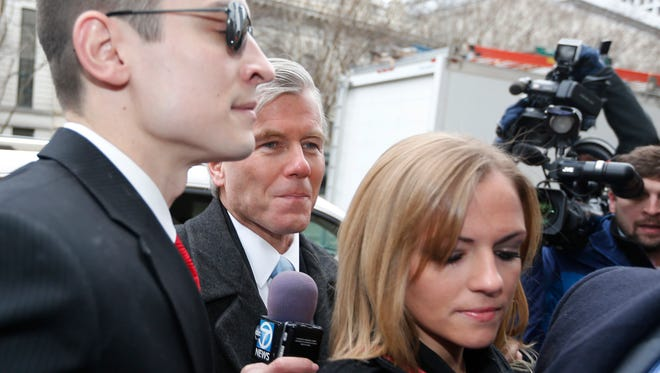 Former Virginia Gov. Bob McDonnell, center, arrives with his daughter Rachel McDonnell, right, and son-in-law Chris Young, for sentencing in Richmond, Va., Tuesday, Jan. 6, 2015.  McDonnell, once a top Republican prospect for national office, was convicted for selling the influence of his office to the CEO of a dietary supplements company. (AP Photo/Steve Helber)