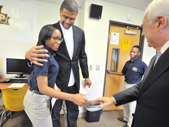 Both Jiyah Pitt, 16, with Jalen Rose and Doug Ross,