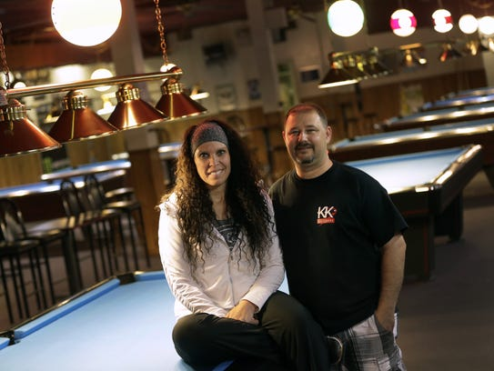 Penny and Chris Knutson, owners of KK Billiards, are