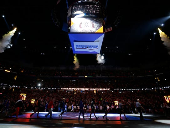 The March of Champions at the WIAA state wrestling tournament at the Kohl Center in Madison.