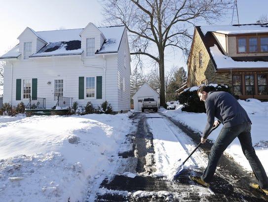Airbnb host Joshua Skog prepares his home inside and