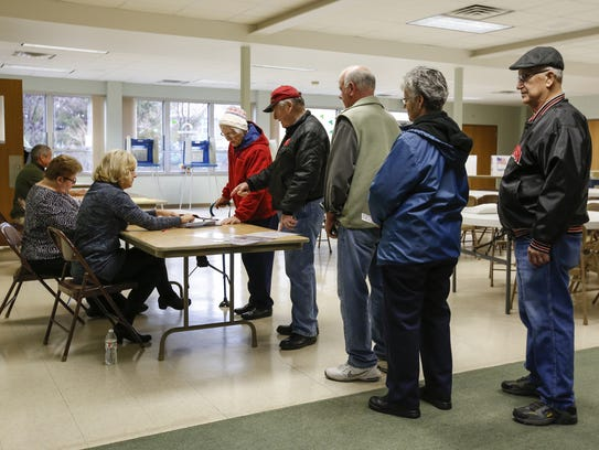 Voters stand in line to cast their ballots at Redeemer