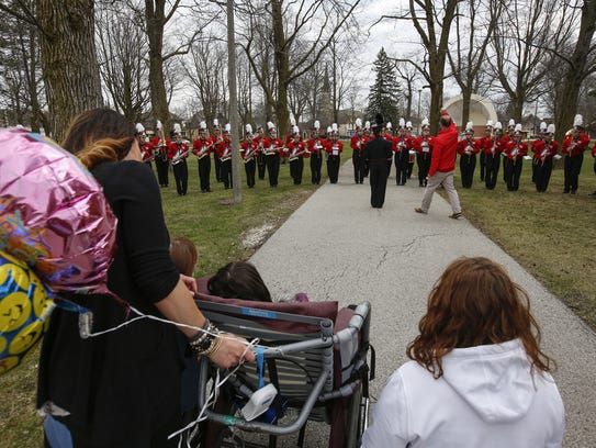 The Lincoln High School marching band plays for Challise