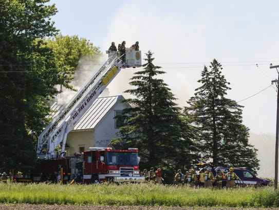 Fire departments work to put out a fire at 4107 Marken