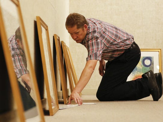 Rahr-West curator Adam Lovell spaces out the prints
