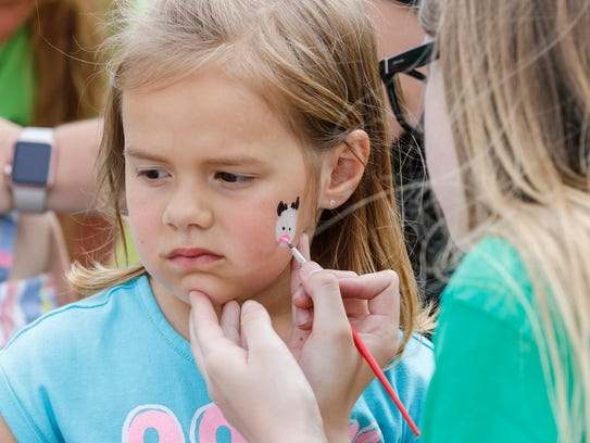 Isabella Daul, 4, of De Pere sits patiently as she