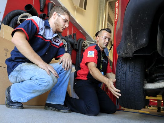 Instructor Clint Braun (right) works with Green Bay