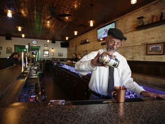 Bartender Charlie Kurth serves up a Moscow mule at
