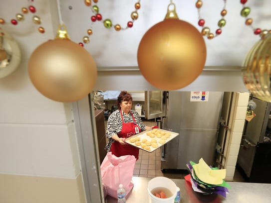 Barb Bonifas works in the kitchen preparing the New Years lunch for those in need at the Salvation Army on Friday, December 29, 2017 in Green Bay, Wis. Adam Wesley/USA TODAY NETWORK-Wisconsin