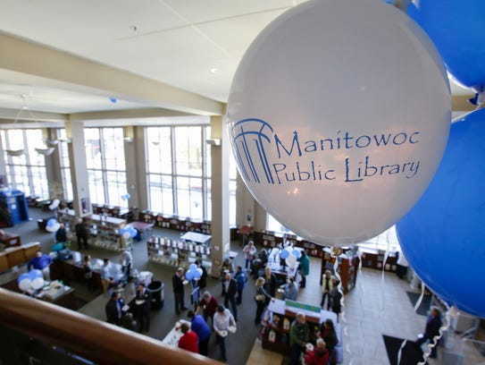 A balloon decorates the balcony of the Manitowoc Public Library during the grand re-opening of Thursdays ribbon cutting Feb. 15. The balcony overlooks the first floor of the library which will be redesigned over the next few years.