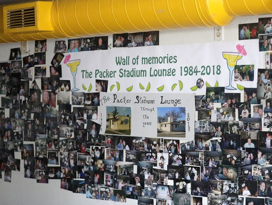 A wall of memories is covered with photos of patrons