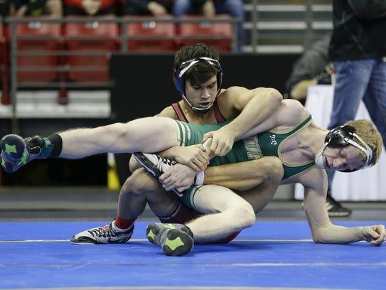 Oshkosh North's Dalton Holmes wrestles in the Division