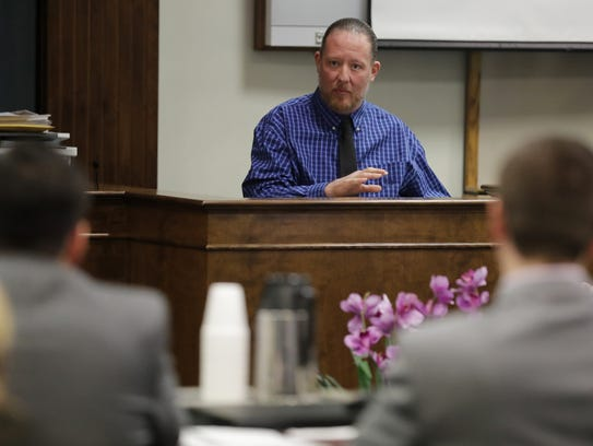 George Burch answers questions from the witness stand