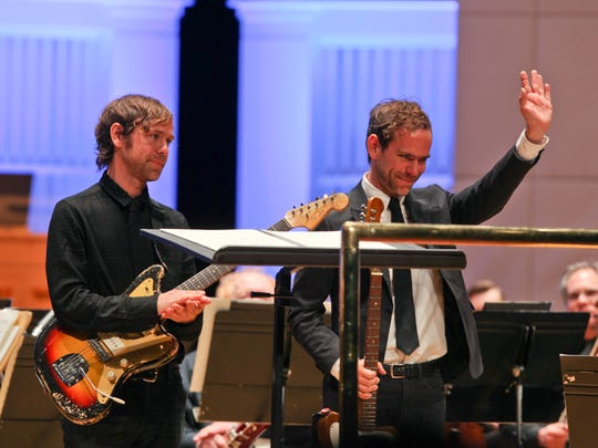 """Aaron and Bryce Dessner performed Bryce Dessner's """"St. Carolyn by the Sea"""" with the Cincinnati Symphony Orchestra last year."""