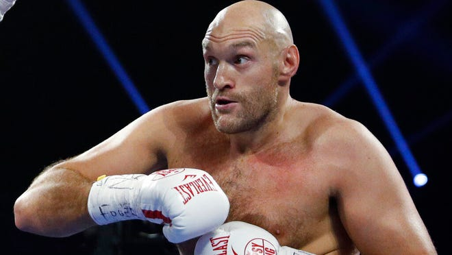 From June 15, 2019, Tyson Fury, of England in action against Tom Schwarz of Germany, in Las Vegas, USA.  Tyson Fury has changed trainers just two months before his likely heavyweight rematch with WBC champion Deontay Wilder, it is revealed Monday Dec. 16, 2019.
