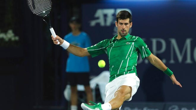 Serbia's Novak Djokovic shoots the ball to Germany's Philipp Kohlschreiber during a match of the Dubai Duty Free Tennis Championship in Dubai, United Arab Emirates, Wednesday, Feb. 26, 2020.
