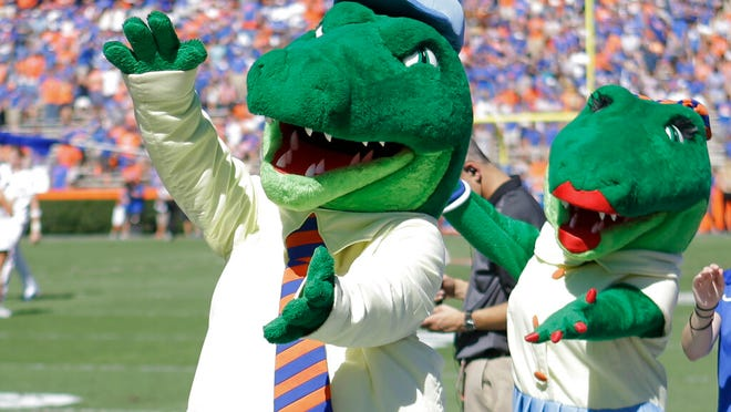 The University of Florida ended its 'gator bait' cheer at football games and other sports events because of its racial connotations, the school's president announced in June.